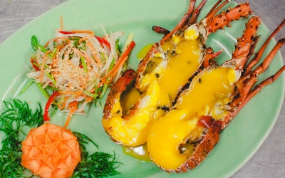Steamed lobster served with passion fruit sauce
